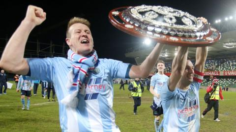 Scotsman Allan Jenkins and team captain Jim Ervin parade the Shield in front of delighted Ballymena supporters