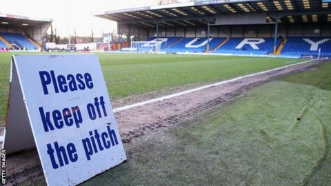 Sign pitchside at Gigg Lane, home of Bury FC