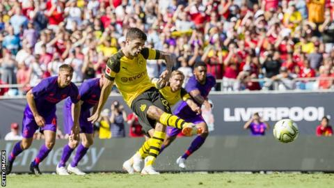 Borussia Dortmund's Christian Pulisic scores his first goal from a penalty