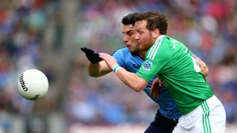 Bernard Brogan and Niall Cassidy try to win a chase for the ball as Dublin face Fermanagh for a place in the last four of the All-Ireland