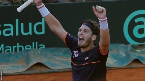 Cameron Norrie celebrates beating Roberto Bautista Agut