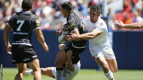 Joseph Tapine of New Zealand is tackled by Sam Burgess of England during a Rugby League Test Match between England and the New Zealand Kiwis at Sports Authority Field at Mile High on June 23, 2018 in Denver, Colorado.