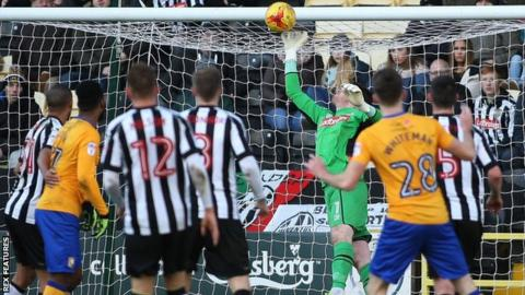 Notts County goalkeeper Adam Collin makes a save against Mansfield Town