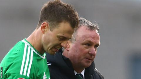 NI defender Jonny Evans with team manager Michael O'Neill