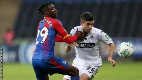 Crystal Palace defender Aaron Wan-Bissaka challenges Declan John of Swansea City