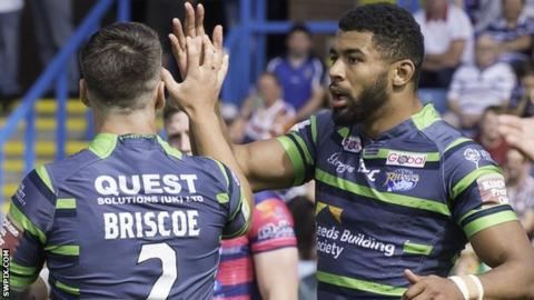 Kallum Watkins celebrates one of his tries for Leeds Rhinos against Featherstone