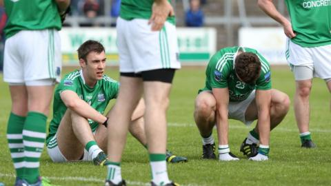 Fermanagh players Conall Jones and Eoin Donnelly show their disappointment after the final whistle