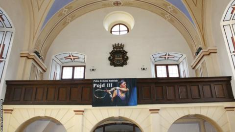 The Petra Kvitova fan club's banner hangs in the Fulnek church that exhibited her trophies in 2015