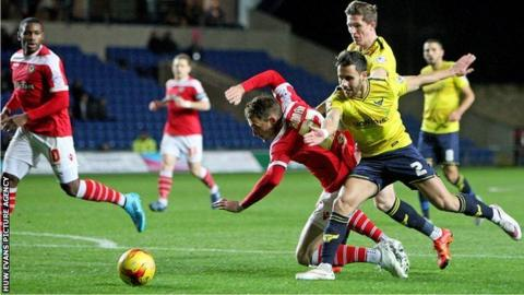 Alex Rodman is fouled by an Oxford defender