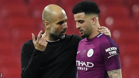 Pep Guardiola speaking to Kyle Walker