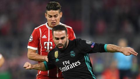 """James Rodriguez (back) challenges Real Madrid""""s Spanish defender Dani Carvajal"""