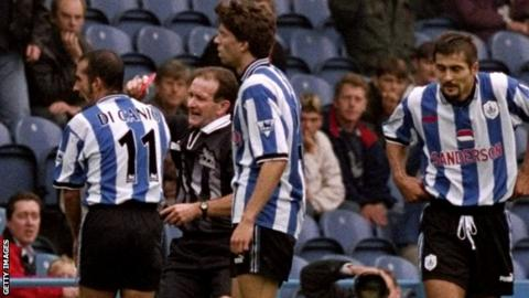 Referee Paul Alcock being pushed over by Paolo di Canio in a Premier League match in 1998