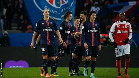 Paris St-Germain players celebrate a goal in Ligue 1