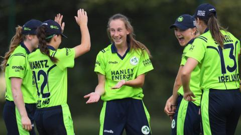 Ireland celebrate a wicket by Orla Prendergast