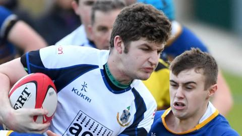 Belfast High's Thomas McFarland in Schools' Cup action against Christopher McKee of Limavady