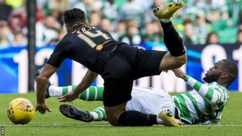 Celtic's Olivier Ntcham challenges Egli Kaja of Livingston