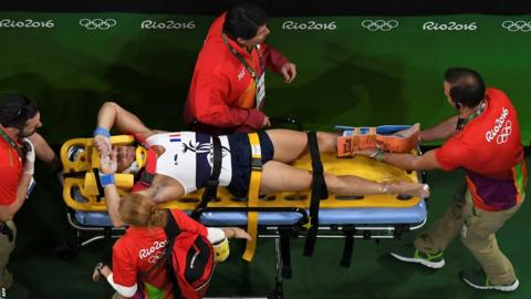 France's Samir Ait Said being stretchered off after being injured while competing in the qualifying for the men's vault event of the Artistic Gymnastics
