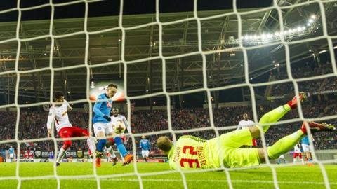 Piotr Zielinski scores Napoli's opening goal against RB Leipzig