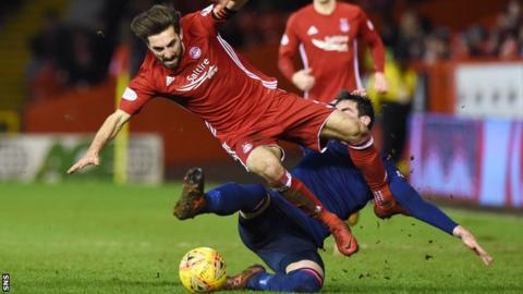 Hearts striker Kyle Lafferty fouls Aberdeen's Graeme Shinnie
