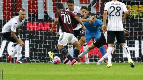 Carlos Bacca scores his first goal for AC Milan against Palermo