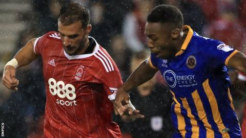 Nottingham Forest's Apostolos Vellios and Shrewsbury Town's Ebou Adams (right) battle for the ball