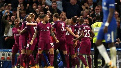 Manchester City celebrate scoring at Chelsea