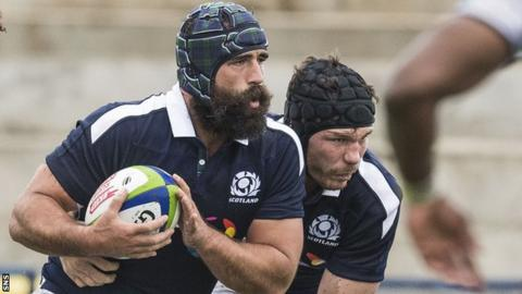 Josh Strauss carries the ball for Scotland against Fiji in June 2017
