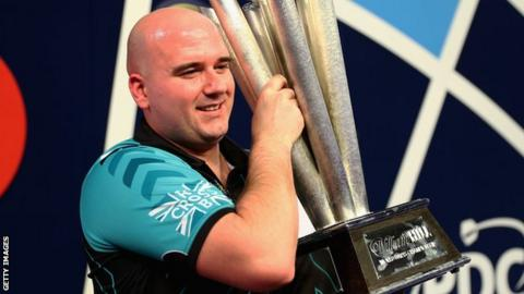 Rob Cross with the PDC World Darts Championship trophy