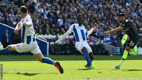 Riyad Mahrez scores Manchester City's third goal against Brighton