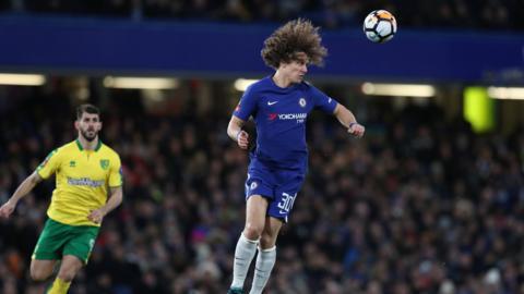 David Luiz heads clear