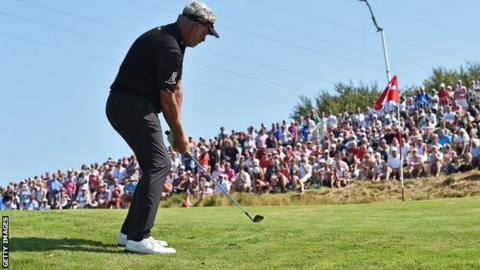 Darren Clarke plays a chip shot in Denmark on Friday