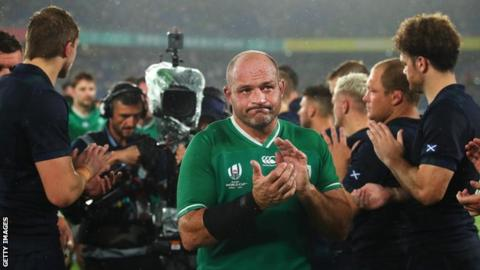 Rory Best is applauded off the field by All Blacks players after Ireland's World Cup quarter-final defeat