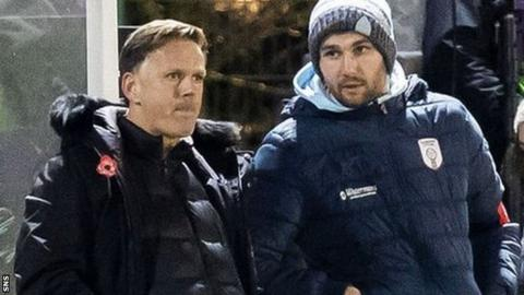 Glasgow City head coach Scott Booth (left) watches his side face Barcelona