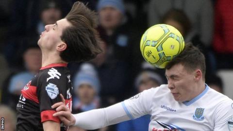 Crues midfielder Jamie Glackin gets a nudge from Sky Blues defender Kofi Balmer