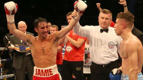 Jamie Conlan celebrates his Commonwealth title victory over Anthony Nelson