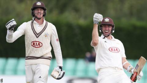 Morne Morkel and Rikki Clarke walk off after guiding Surrey to victory against Worcestershire