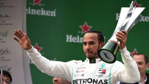 Lewis Hamilton celebrates winning the Chinese Grand Prix in 2019