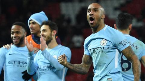 Fabian Delph and his team-mates celebrate beating Manchester United