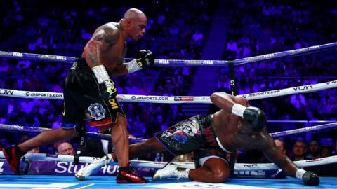 London, England, 20 July: Dillian Whyte's chances of a shot at the WBC world heavyweight title look to be in the balance as he hit the canvas in the ninth round of a final eliminator at The O2 Arena, but he got up to beat Oscar Rivas on points. (Photo by Dan Istitene/Getty Images)