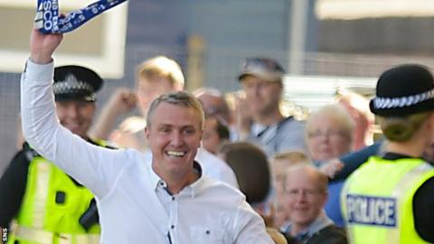 Lee Clark celebrates Kilmarnock's third goal by running down the touchline and grabbing a scarf