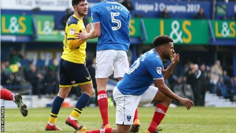 Nathan Thompson goes to ground after Alex Mowatt shoves him