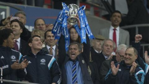 Jose Mourinho lifts the League Cup