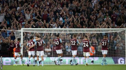 Aston Villa players celebrate with the home fans