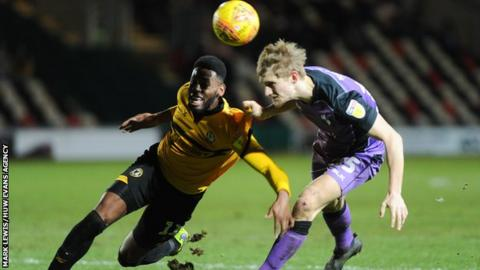 Jamille Matt of Newport County and Nathan Smith of Port Vale battle for the ball