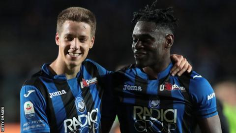 Mario Pasalic, left, celebrates his goal with team-mate Duvan Zapata, who has netted 21 league goals this season