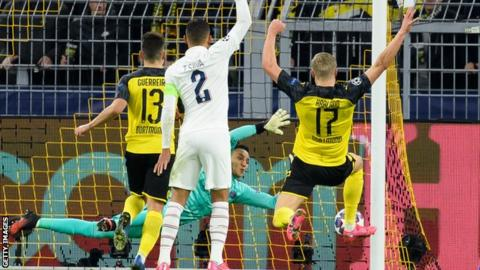 Teenager Haaland scores twice as Dortmund beat PSG thumbnail
