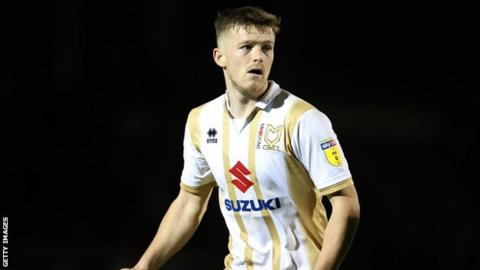 Rhys Healey in action for MK Dons