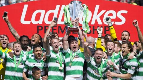 Celtic captain Scott Brown lifts the Premiership trophy