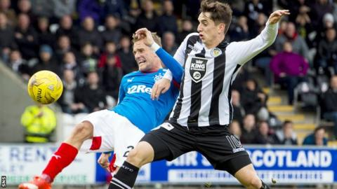 Rangers' Dean Shiels is tackled by St Mirren's Stuart Carswell
