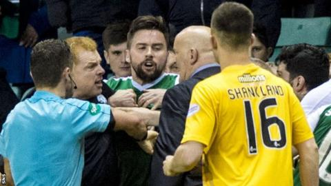 Hibernian and Morton players and managers become involved in a melee